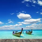 ceb56shutterstock_114440146_548_600---tropikal-deniz-icerisinde-kanolar-ve-bulutlu-gokyuzu